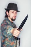 Knife in a hunter's hand Royalty Free Stock Photo