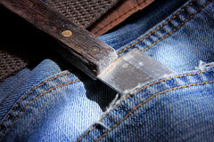 Knife in jeans pocket Stock Image