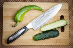 Knife kitchen with a blade from Damask steel Stock Images