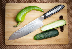 Knife kitchen with a blade from Damask steel Stock Photo