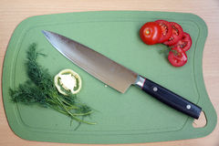Knife kitchen with a blade from Damask steel Royalty Free Stock Photo