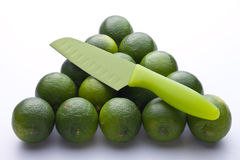 Knife with limes Stock Photography