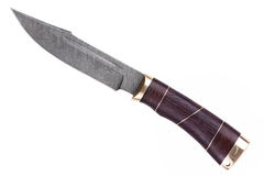Knife made of Damascus steel with a wooden handle. On a white background Royalty Free Stock Photography