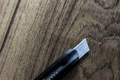 Knife model wooden background Stock Photo