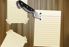 Knife in a note Stock Photos