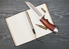 Knife and notebook Stock Photo
