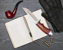 Knife and notebook Royalty Free Stock Photography