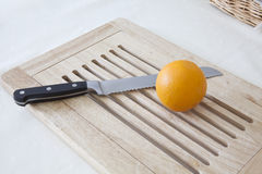 Knife and orange Royalty Free Stock Photos