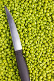 Knife and Peas Stock Images