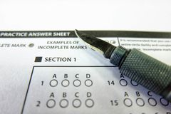 The knife pen selected choice on answer sheets. The knife pen drawing selected choice on answer sheets Royalty Free Stock Photos