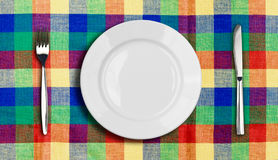 Knife plate and fork multicolor tablecloth Stock Photo