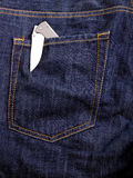 Knife in a pocket. Open knife in jeans pocket Royalty Free Stock Photography