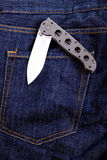 Knife in a pocket. Open knife in jeans pocket Royalty Free Stock Photo