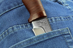 Knife in the pocket of jeans Stock Photos