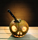 The knife in the pumpkin head for Halloween Royalty Free Stock Images