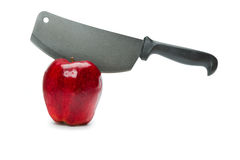 Knife in a red apple Royalty Free Stock Photography