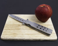 Knife   red apple. Knife red apple  on a cutting board Stock Photo