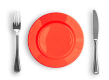 Knife, Red Plate And Fork Isolated Top View Royalty Free Stock Photo
