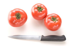 Knife and red tomato Stock Photos