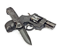 Knife and revolver Royalty Free Stock Photos