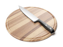 Knife on round cutting board Royalty Free Stock Images