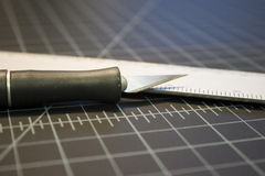 Knife and ruler. Craft knife and ruler on cutting board Stock Photo