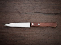 Knife on rustic kitchen table Stock Photos
