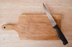 Knife on rustic kitchen table. Knife on rustic kitchen wooden table with copy space Royalty Free Stock Image