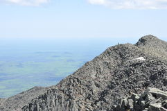 Knife's Edge. A solitary hiker contemplates the route across Knife's Edge from Baxter Peak to Pamola Peak of Mount Katahdin, Maine's highest peak Stock Photos