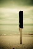 Knife in sand. On the beach stock photos