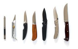 Knife set in line over white Royalty Free Stock Photos