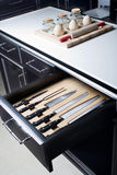 Knife set in modern kitchen. Knife set in an opened drawer of modern kitchen Royalty Free Stock Photos
