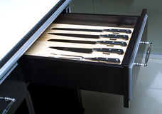 Knife set in modern kitchen. Knife set in an opened drawer of modern kitchen Stock Photography