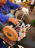 Knife sharpener down the street Royalty Free Stock Photos