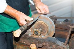 The knife sharpener old craft Stock Photos