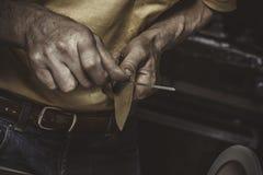 Knife Sharpener. Tecnology. Master's hands Stock Photo
