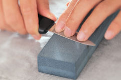Knife sharpening. Closeup view of knife sharpening stock images