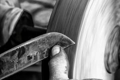 Knife Sharpening On Wet Grinder Stock Photos