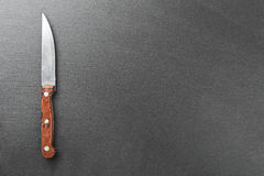 Knife on the slate board Royalty Free Stock Photo
