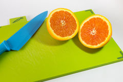 Knife And Slice Of Oranges. On A Chopping Board royalty free stock photo