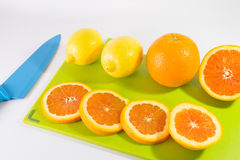 Knife And Slice Of Oranges. On A Chopping Board stock photo