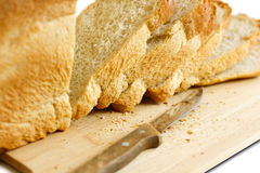 Knife sliced Golden bread. Isolated on white background Stock Photo