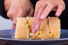 Knife Slicing Banana Cake Stock Images