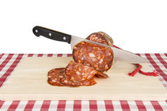 Knife slicing a Spanish sausage called morcon Royalty Free Stock Photos