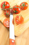 Knife and small tomatoes Stock Photo
