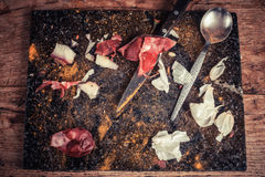 Knife and spoon on chopping board Royalty Free Stock Photography