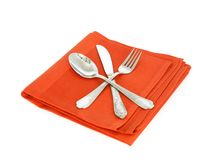 Knife, spoon and fork on red napkin isolated on wh Royalty Free Stock Photography