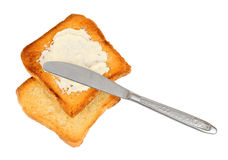 Knife on spreaded crispy toasts Royalty Free Stock Image
