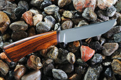 Knife on stones Stock Images