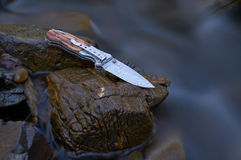 Knife in the stream Stock Image